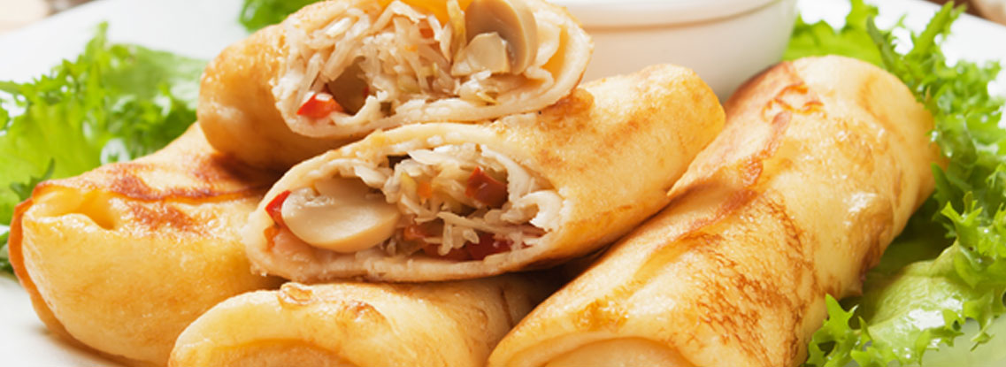 A stack of Philly Cheesesteak Egg Rolls