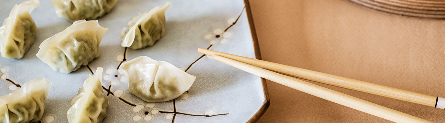 Dumplings on plate with chopsticks